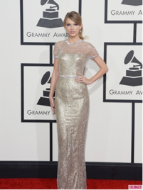 Taylor Swift looked class in gorgeous in this gold Gucci gown.