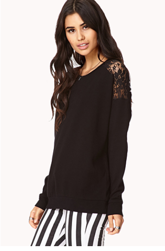 This top is more casual yet edgy with its solid black color and subtle lace embellishment on the shoulder.